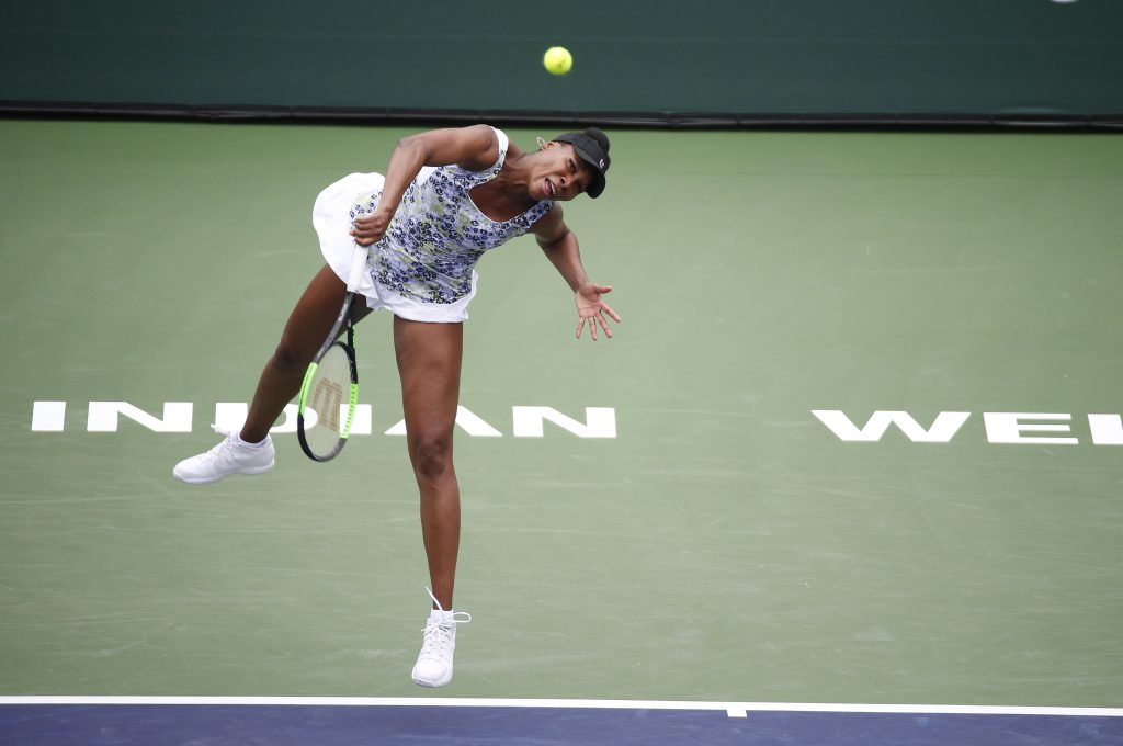 Venus Williams serves against Sorana Cirstea