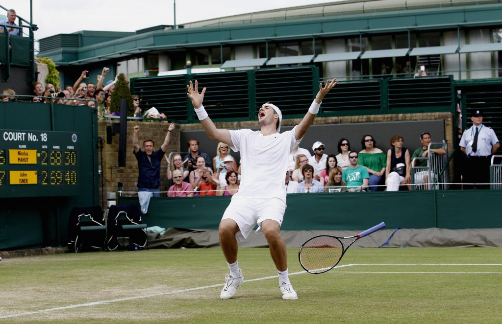 USA's John Isner celebrates victory over France's Nicolas Mahut