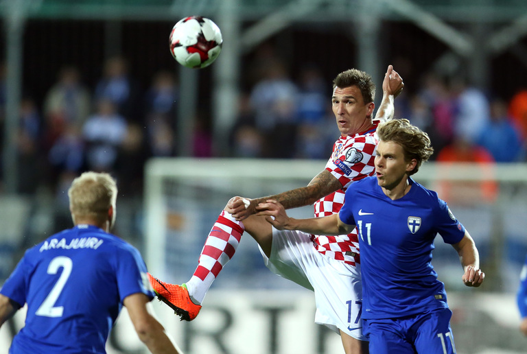 World Cup 2018 Group D contains Croatian striker Mario Mandžukić pictured here challenging for the ball against Finland