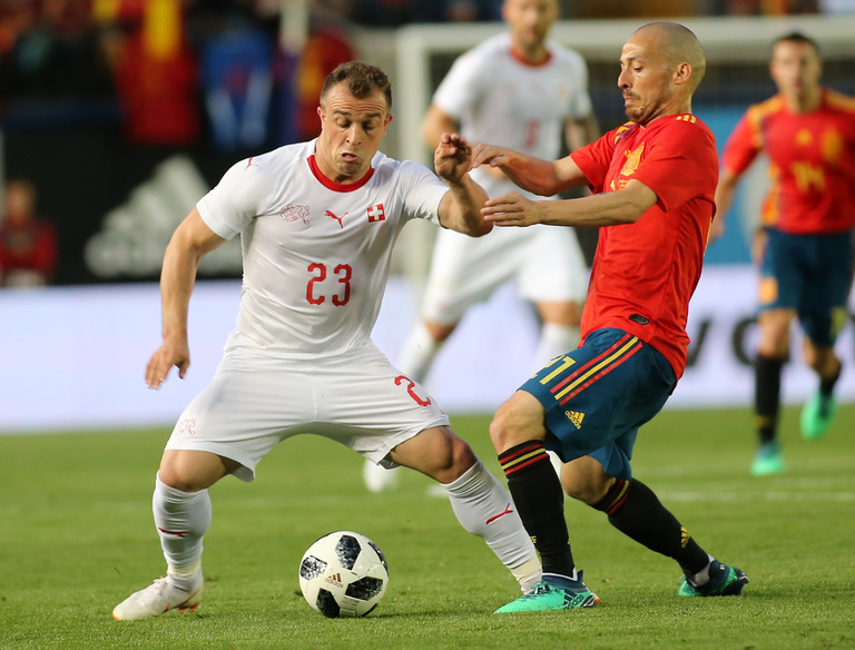 World Cup 2018 underdogs Switzerland have Xherdan Shaqiri pictured here (Left) with David Silva during a friendly