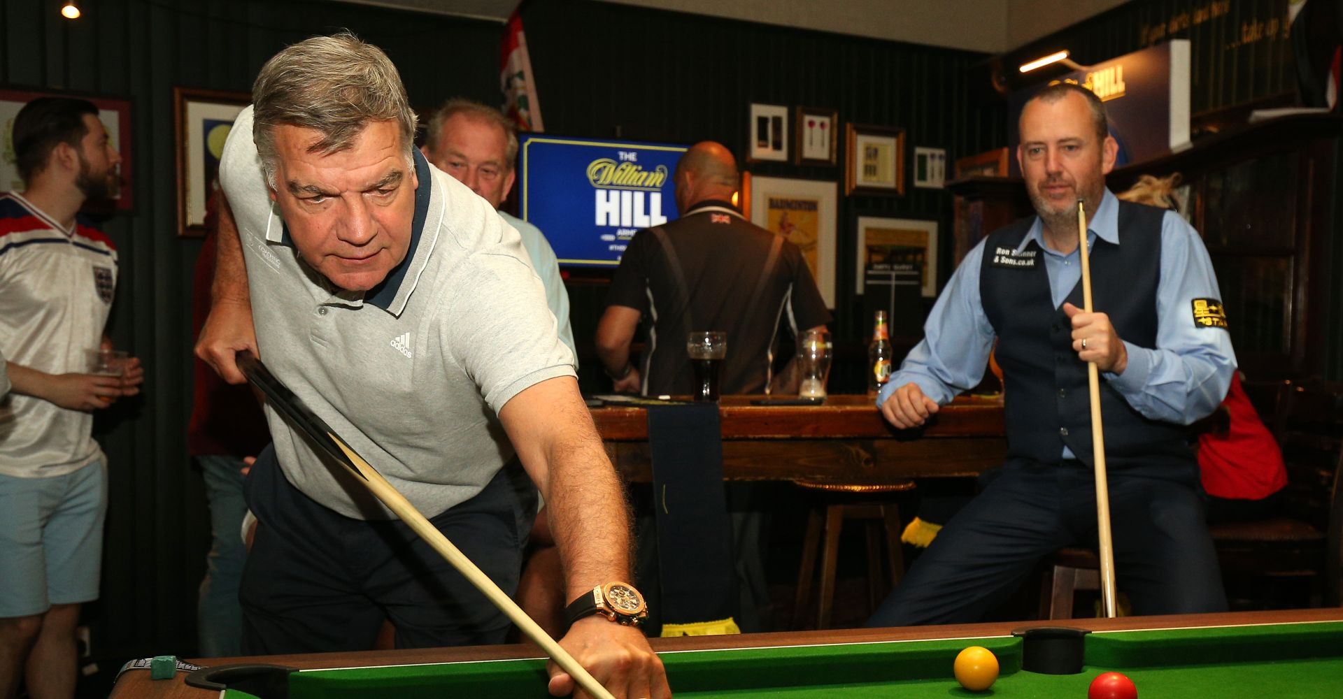 Big Sam playing pool at the William Hill Arms