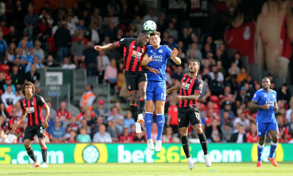 Harry Maguire challenging for the ball against Bournemouth. We've tipped him to defend well as part of our Leicester vs Huddersfield predictions