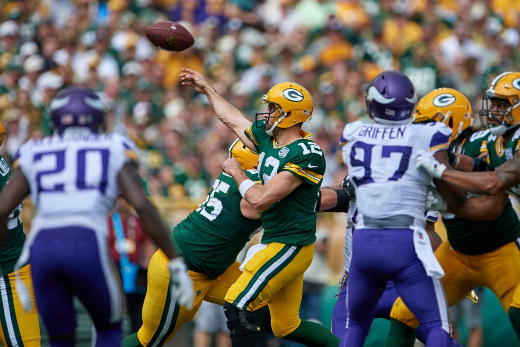Aaron Rodgers playing against the Vikings