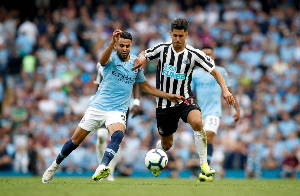 Ayoze Perez fighting for possession against Man City. He's ben tipped to score as part of our Crystal Palace vs Newcastle predictions